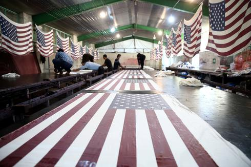 Iranian factory makes U.S. and Israel flags to burn