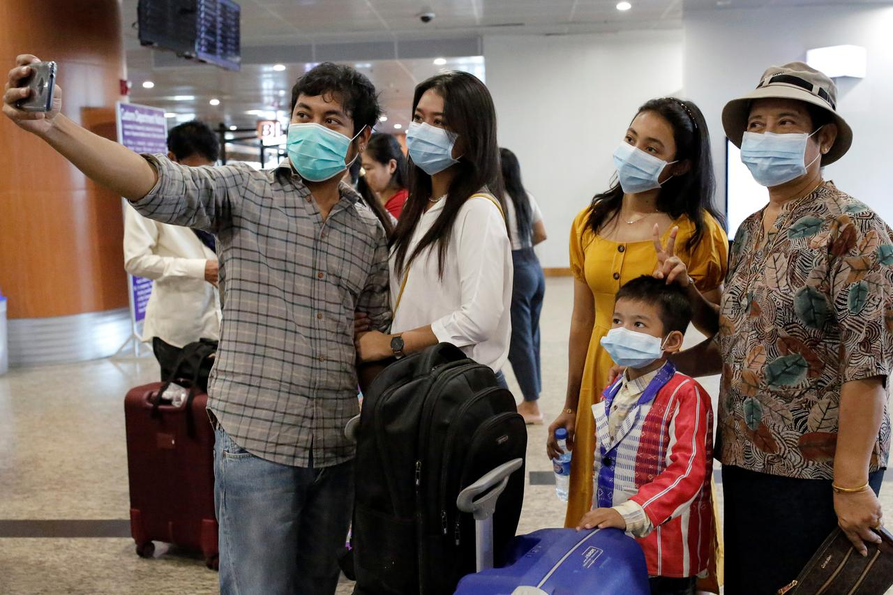 Myanmar students flown home from coronavirus-stricken Wuhan - Reuters