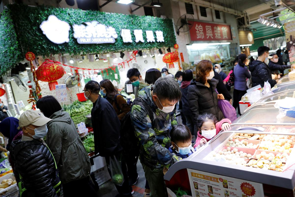 Fearing virus, Hong Kong residents stock up on food, essentials