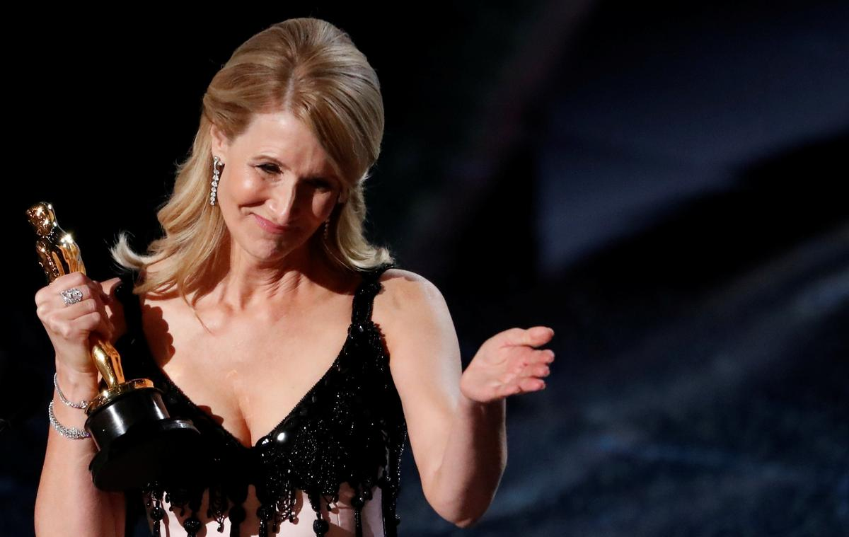Laura Dern, Brad Pitt win first acting Oscars; Obamas' film makes Academy Awards debut