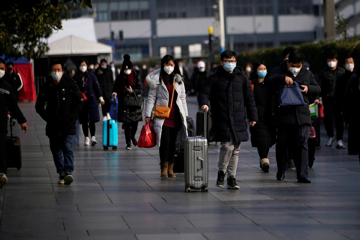 China reports record daily virus death toll, but new cases fall