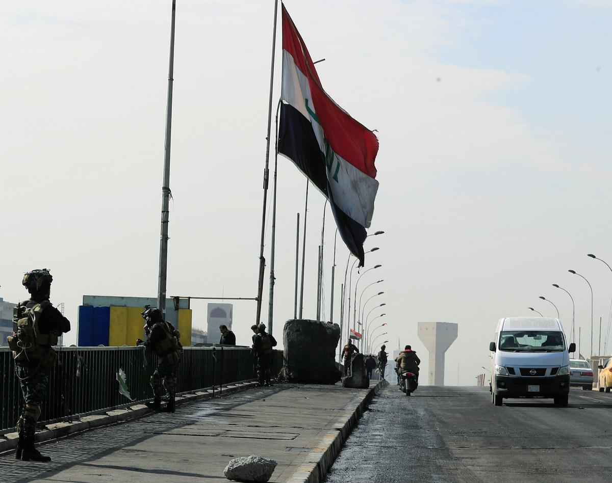 Iraqi authorities reopen Baghdad bridge shut for months by protests