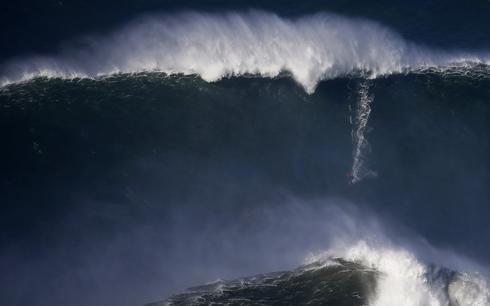 Surfers brave monster waves of Portugal's Nazare