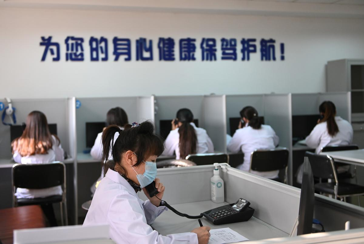 Chinese public dial in for support as coronavirus takes mental toll
