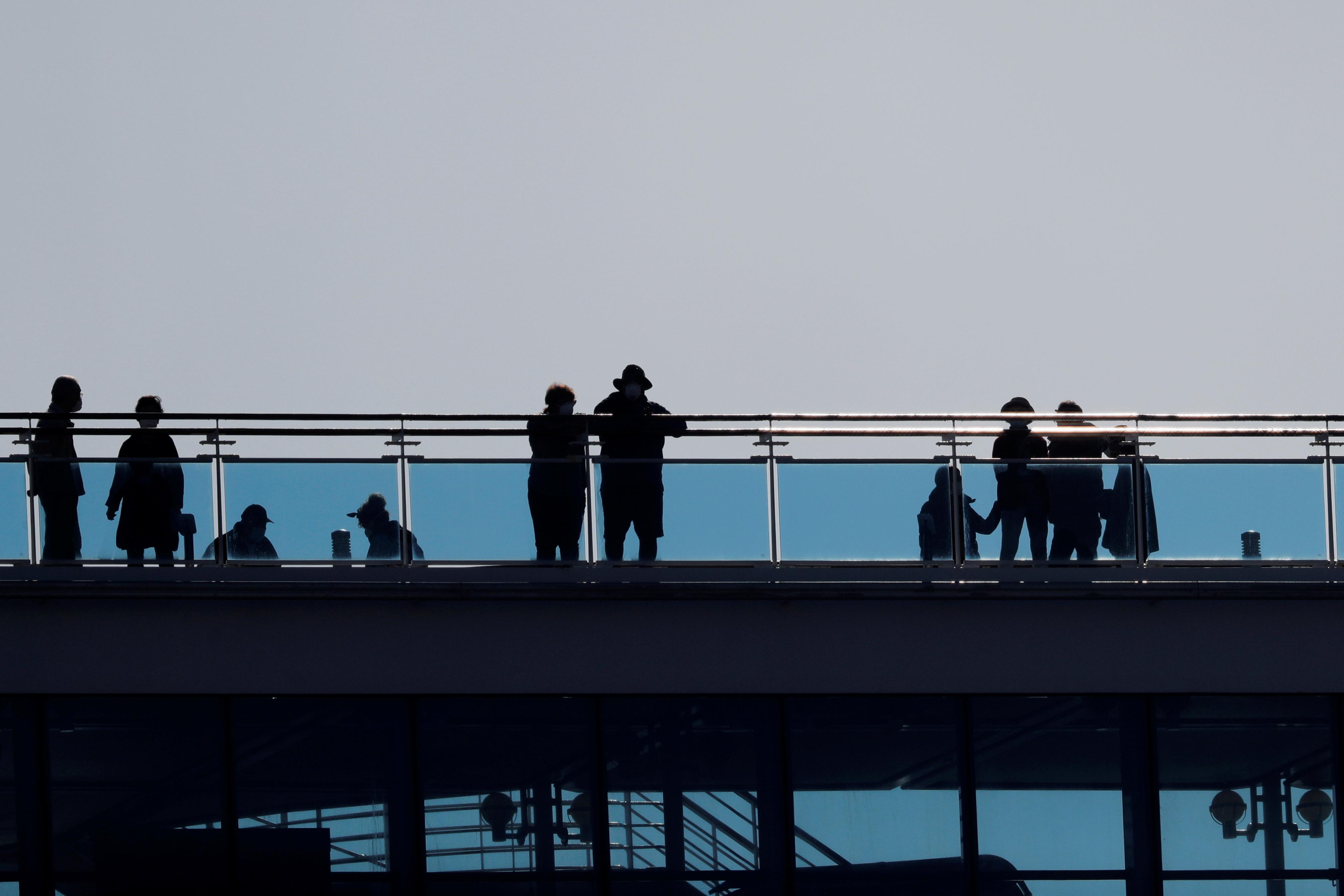 Coronavirus cruise ship ordeal to end early for some as Japan allows elderly to leave