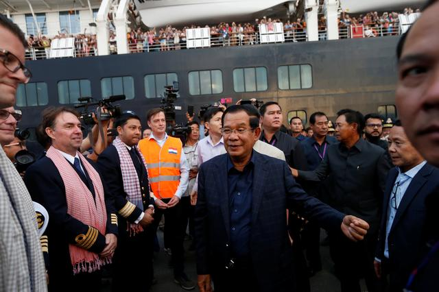 Cambodia's Prime Minister Hun Sen welcomes crews of MS Westerdam, a cruise ship that spent two weeks at sea after being turned away by five countries over fears that someone aboard might have the coronavirus, as it docks in Sihanoukville, Cambodia February 14, 2020.  REUTERS/Soe Zeya Tun