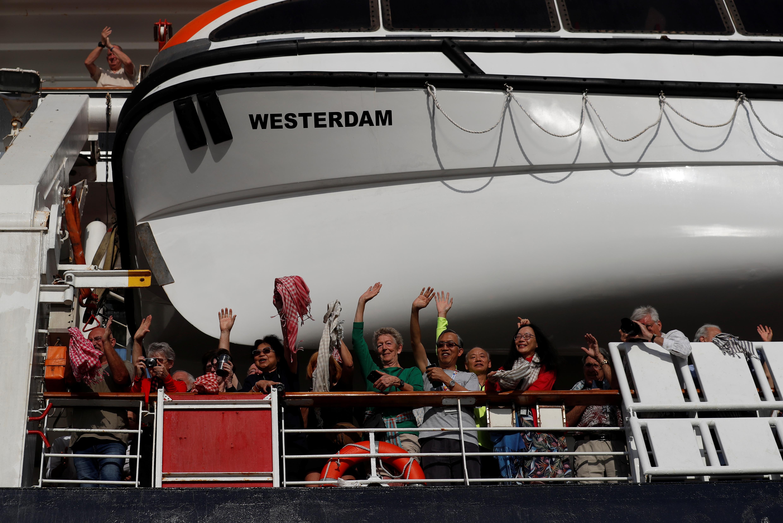 China reports 5,000 new coronavirus cases, cruise ship disembarks in Cambodia