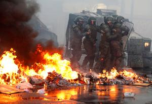 Security forces clash with protesters in Chile