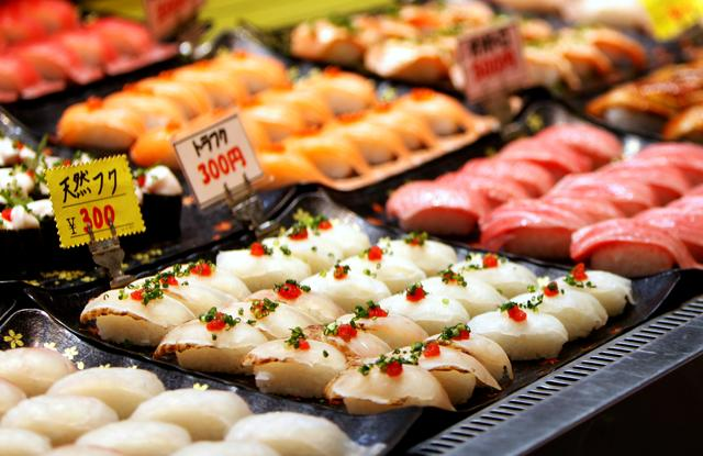 FILE PHOTO: Pufferfish sushi line is seen on a display window at a market in Shimonoseki, Japan February 7, 2020.  REUTERS/Sakura Murakami