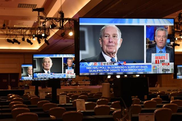 An image of Democratic presidential candidate Michael Bloomberg appears on a video monitor inside the media center for Wednesday?s Democratic presidential debate, in Las Vegas, Nevada, U.S., February 18, 2020.  REUTERS/David Becker