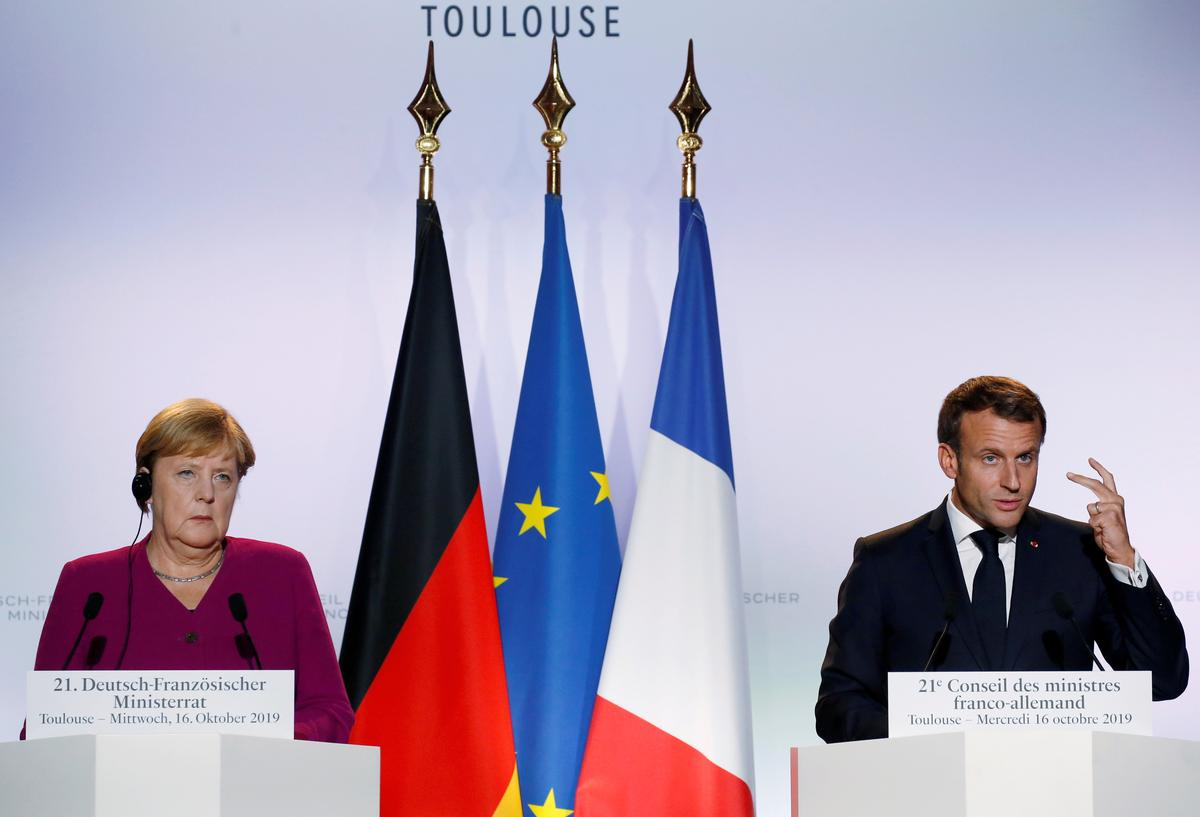 Merkel, Macron urge Putin to end conflict in Syria's Idlib