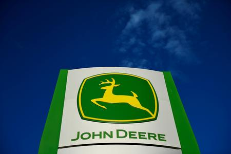 Deere's shares hit five-year high on unexpected rise in quarterly profits