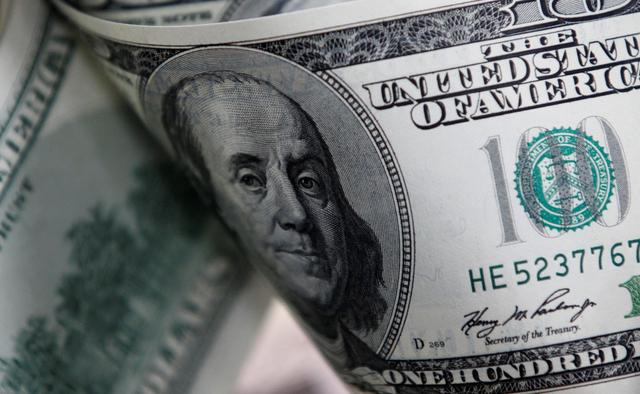 FILE PHOTO: U.S. one hundred dollar notes are seen in this picture illustration taken in Seoul February 7, 2011.  REUTERS/Lee Jae-Won/File Photo