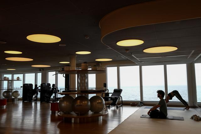 People do yoga at a gym on the Virgin Voyages Scarlet Lady cruise liner at Dover Port in Dover, Britain, February 21, 2020. REUTERS/Simon Dawson