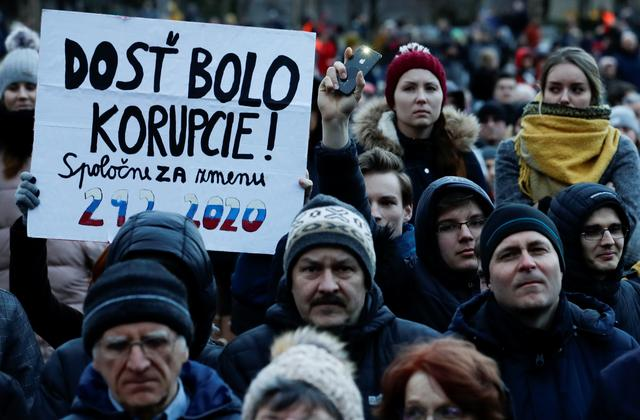 Demonstrators take part in a protest rally marking the second anniversary of the murder of the investigative reporter Jan Kuciak and his fiancee Martina Kusnirova, one week ahead of country's parliamentary election in Bratislava, Slovakia, February 21, 2020. The banner reads: ''Enough with corruption''. REUTERS/David W. Cerny