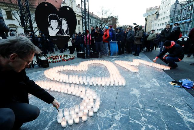Demonstrators light candles during a protest rally marking the second anniversary of the murder of the investigative reporter Jan Kuciak and his fiancee Martina Kusnirova, one week ahead of country's parliamentary election in Bratislava, Slovakia, February 21, 2020. REUTERS/David W. Cerny