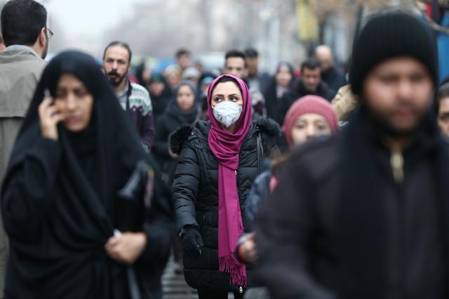 An Iranian woman wearing a protective mask to prevent contracting a coronavirus walks at Grand Bazaar in Tehran, Iran February 20, 2020. WANA (West Asia News Agency)/Nazanin Tabatabaee via REUTERS