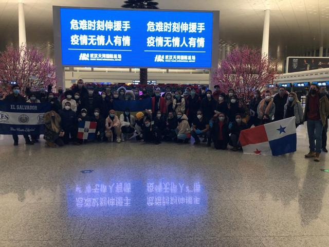 Tourists from around the world pose for a photograph at the airport in Wuhan, China February 20, 2020 in this picture obtained by Reuters from social media on February 21, 2020. INSTAGRAM/@JULIA_VOLOK via REUTERS
