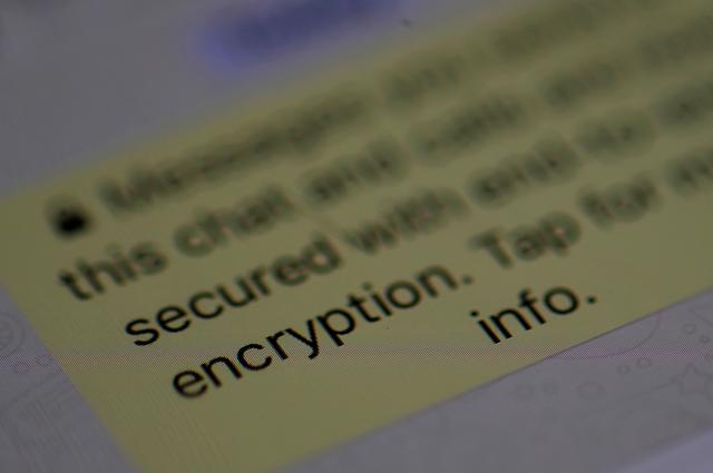 FILE PHOTO: FILE PHOTO: An encryption message is seen on the  WhatsApp application on an iPhone, March 27, 2017. REUTERS/Phil Noble