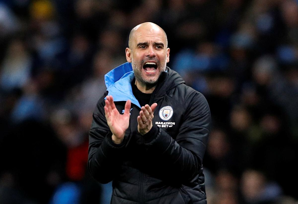 Soccer-Guardiola wants Man City to show 'personality' against Real Madrid