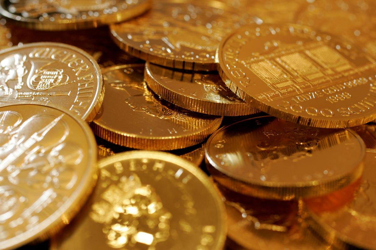 Gold surges to seven-year peak as pandemic fears spark safe-haven rush