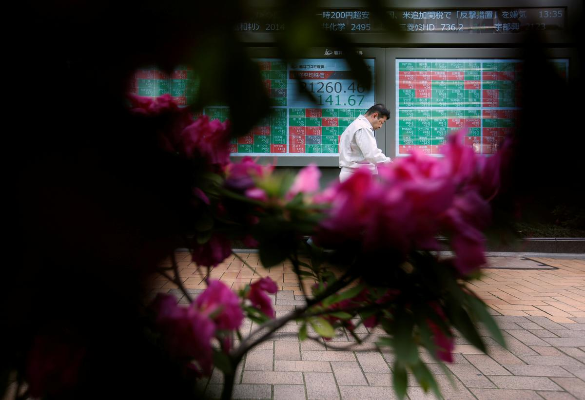 World shares slump for fifth day, bets grow on rate cuts to counter damage