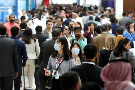 UPDATE 3-UAE says ready for 'worst case' scenarios as coronavirus spreads in Middle East