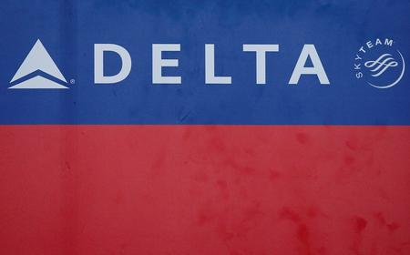 UPDATE 1-Delta cutting flights to South Korea; JetBlue waives U.S. change fees