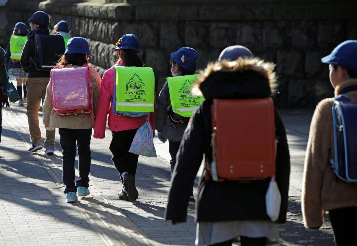 Japan scrambles for workarounds after Abe urges March school shutdown to stem coronavirus