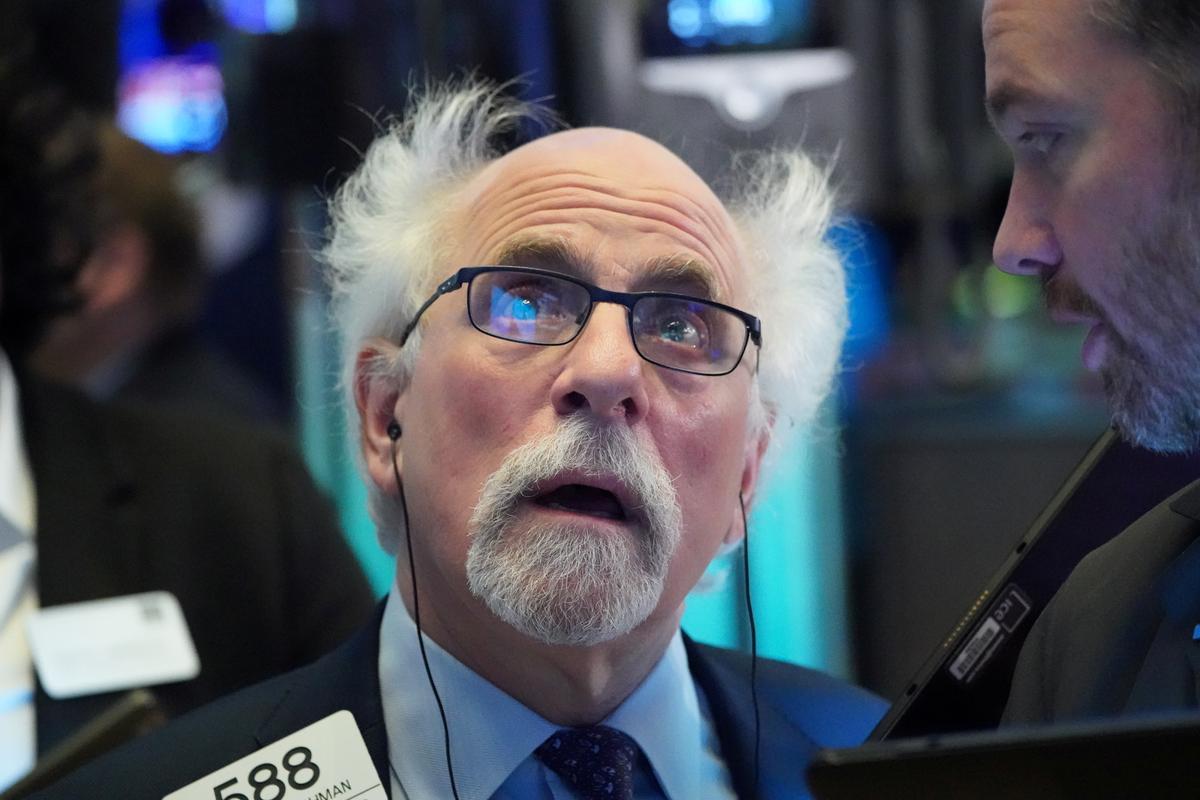 Wall Street clobbered as crude plummets, virus crisis deepens - Reuters