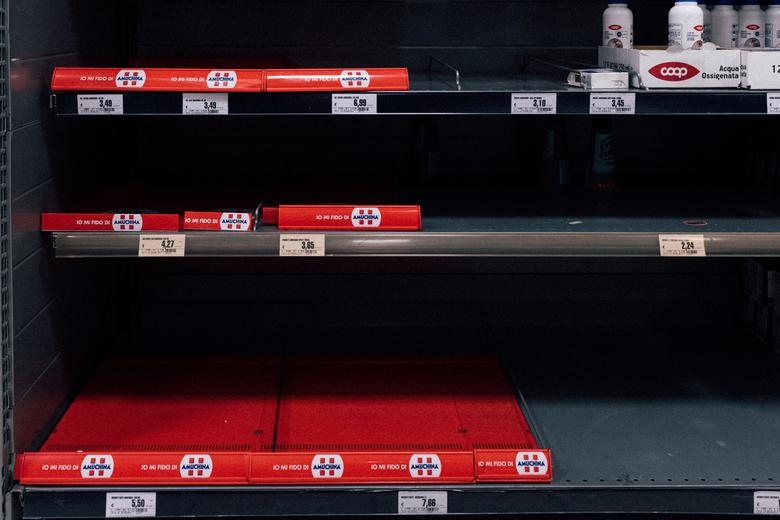 Empty shelves are seen inside a shop in San Fiorano, February 22. Police blocks were put at the entrance to the town and anyone who tries to escape the blockade faces up to three months in prison or a fine of up to 206 euros ($223).  Marzio Toniolo/via REUTERS