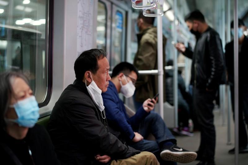 Shanghai downgrades emergency alert level as coronavirus spread subsides