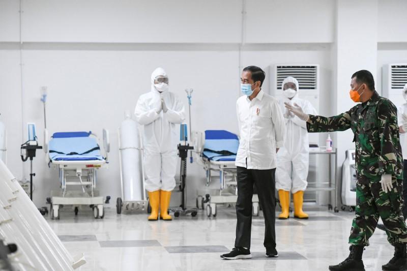 Indonesia invokes emergency measures in Jakarta, bonuses for doctors