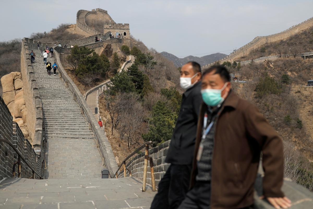 Hubei relaxes restrictions as China's new coronavirus infections double