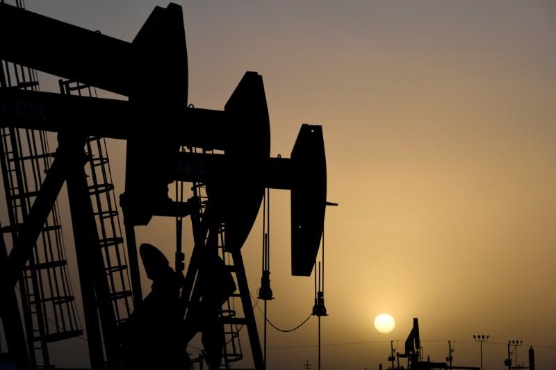 Oil prices settle higher on stimulus package, fuel demand sinks
