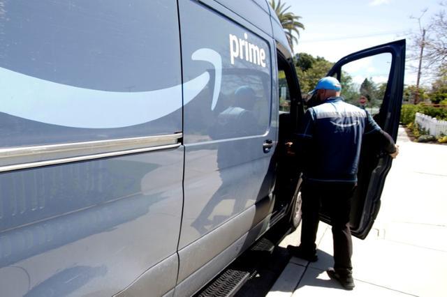 Joseph Alvarado makes deliveries for Amazon during the outbreak of the coronavirus disease (COVID-19) in Costa Mesa, California, U.S., March 23, 2020.      REUTERS/Alex Gallardo