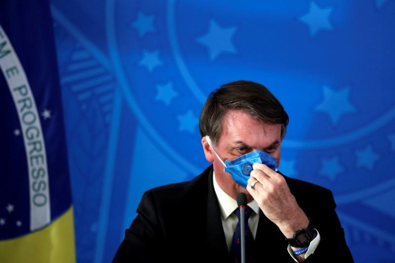 Bolsonaro calls coronavirus lockdown in Brazil's major cities a 'crime'