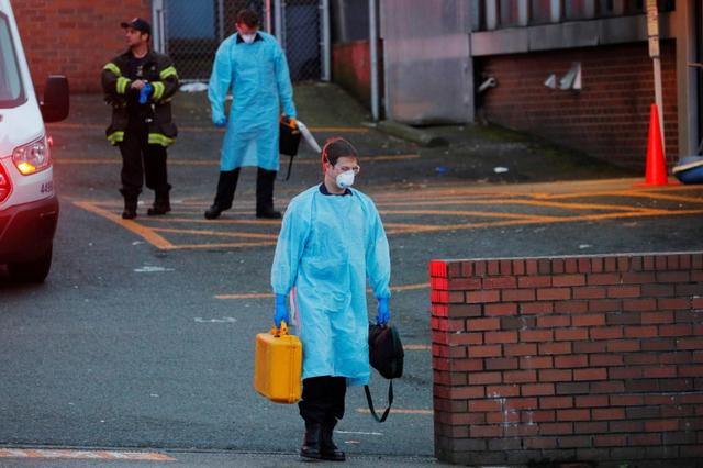 Firefighters wearing personal protective equipment (PPE) walk away after responding to a medical call amid the coronavirus disease (COVID-19) outbreak in Seattle, Washington, U.S., March 24, 2020.   REUTERS/Brian Snyder