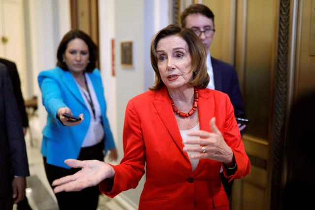 U.S. Speaker of the House Nancy Pelosi (D-CA) speaks to news reporters ahead of a vote on the coronavirus relief bill on Capitol Hill in Washington, U.S., March 25, 2020. REUTERS/Tom Brenner