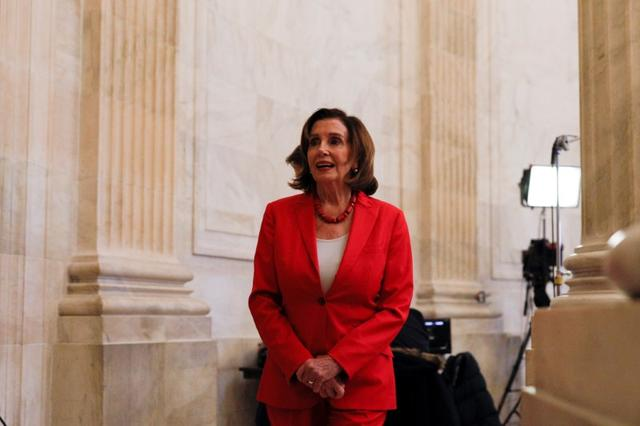 FILE PHOTO: U.S. Speaker of the House Nancy Pelosi (D-CA) speaks to news reporters ahead of a vote on the coronavirus relief bill on Capitol Hill in Washington, U.S., March 25, 2020. REUTERS/Tom Brenner