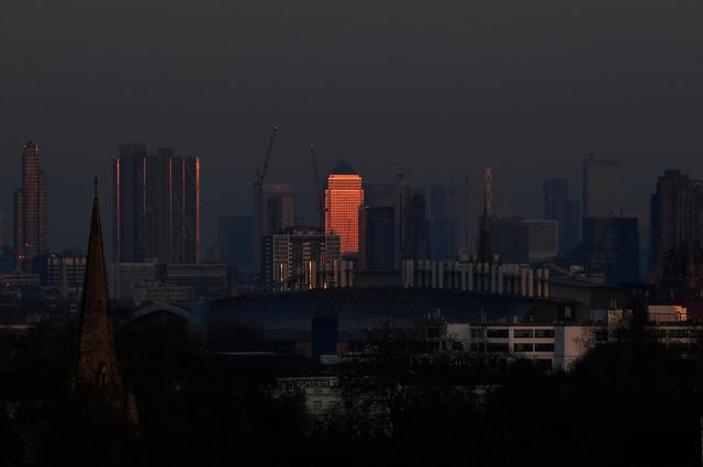 General view of Canary Wharf as the sun sets, as the spread of the coronavirus disease (COVID-19) continues, London, Britain, March 26, 2020. REUTERS/Toby Melville