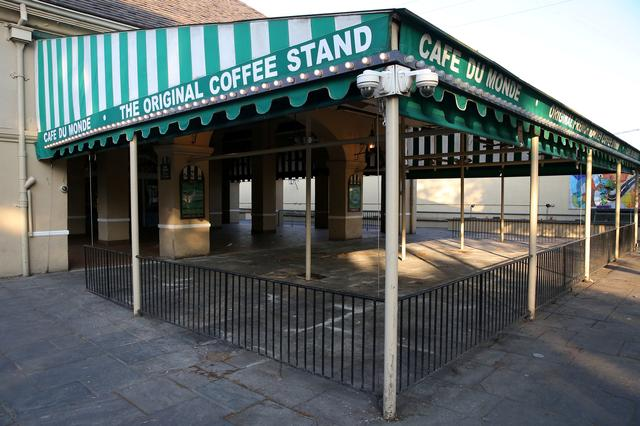 FILE PHOTO: An empty view of the 24-hour French Quarter restaurant Cafe Du Monde amid the outbreak of the coronavirus disease (COVID-19), in New Orleans, Louisiana, U.S. March 25, 2020. REUTERS/Jonathan Bachman/File Photo