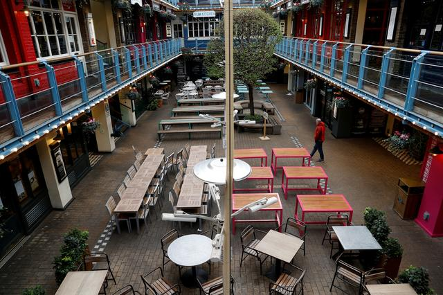 FILE PHOTO: General view of an empty outdoor eating area as the spread of the coronavirus disease (COVID-19) continues. London, Britain March 21, 2020 REUTERS/Peter Nicholls/File Photo