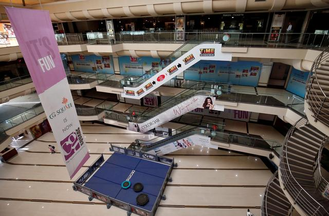 FILE PHOTO: A view of an empty shopping mall is seen after Gujarat state government banned public gatherings to avoid the spreading of the coronavirus, in Ahmedabad, India, March 16, 2020. REUTERS/Amit Dave/File Photo