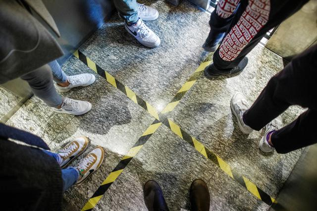 Lines serving as a guide for social distancing are seen in a lift in a department store in Beijing following an outbreak of the novel coronavirus disease (COVID-19), China, March 25, 2020. Picture taken March 25, 2020.  REUTERS/Thomas Peter