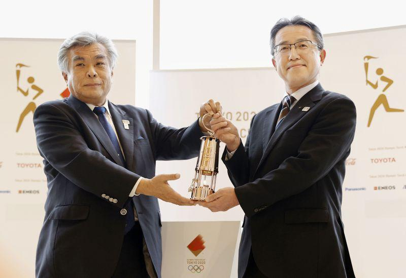 Olympic flame passed to Fukushima during low-key ceremony