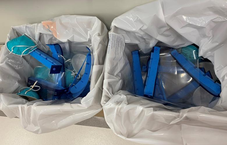 Face shields and masks worn by healthcare workers treating COVID-19 patients at Mount Sinai Hospital are dropped in a bin to be sanitized for reuse because of a personal protective equipment shortage, in New York City, March 28, 2020. Handout via REUTERS