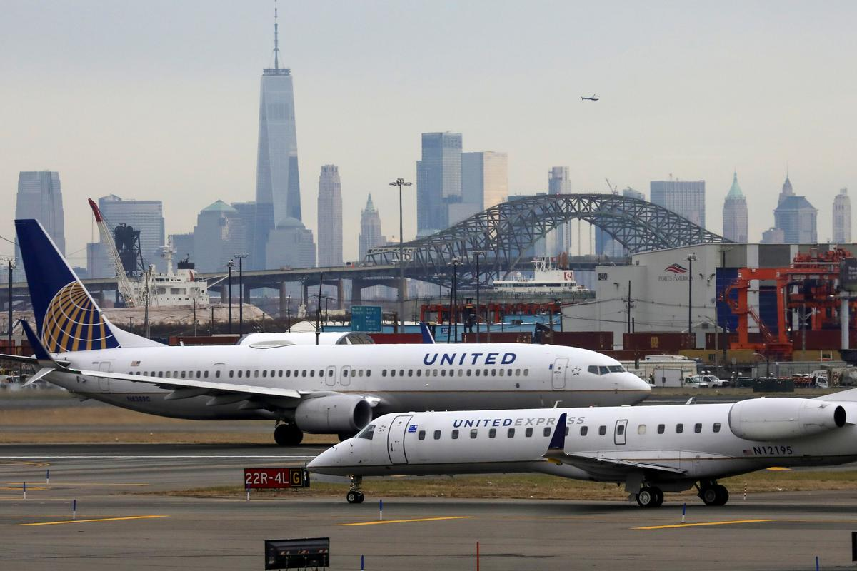 United slashes New York-area flights due to coronavirus - Reuters