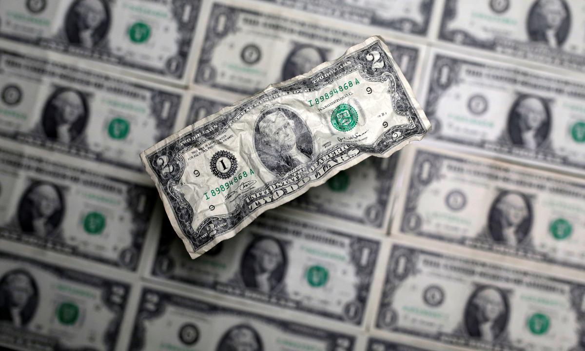 Dollar dips as pandemic worries persist despite some signs of hope
