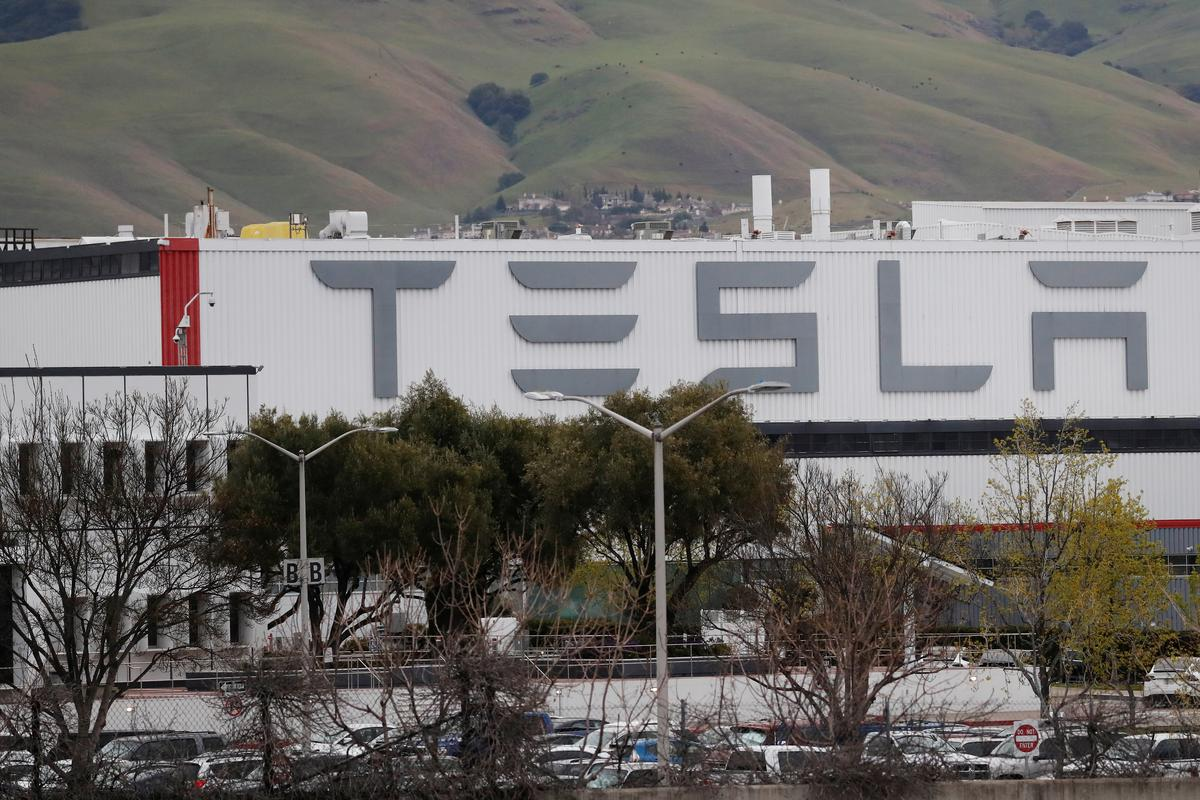 Tesla is calling some workers back to California factory: Bloomberg News